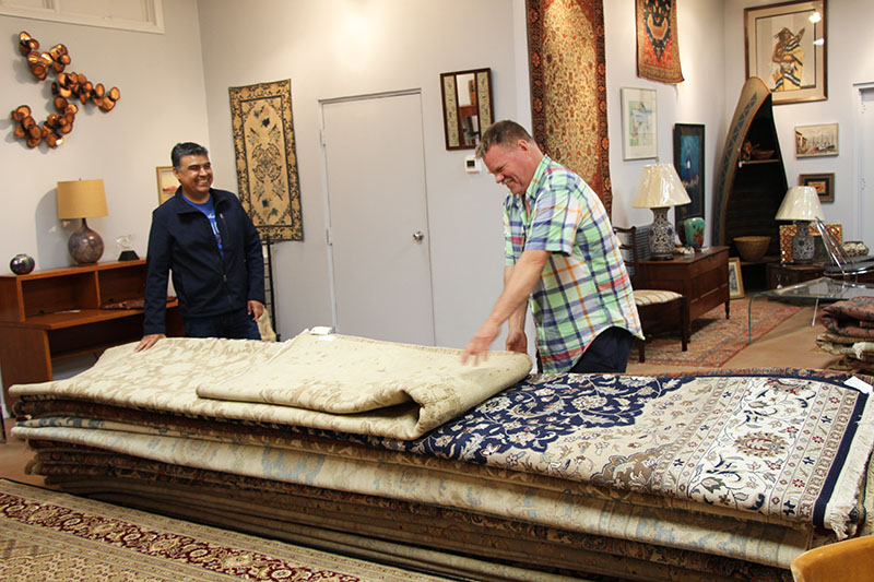 selecting-rugs-in-showroom